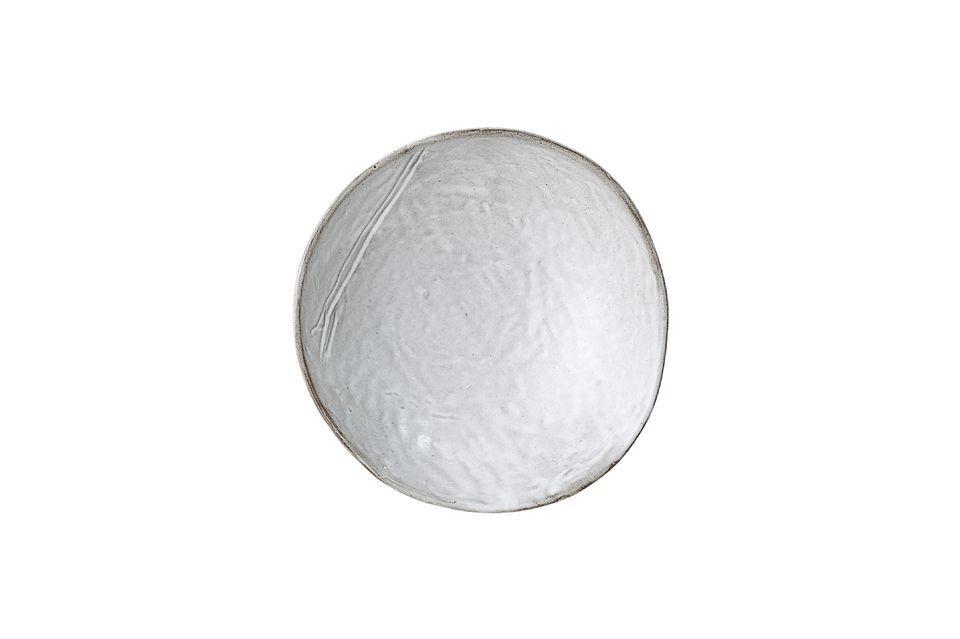 Ce bol en grès de couleur grise sort de l\'ordinaire par son rebord asymétrique