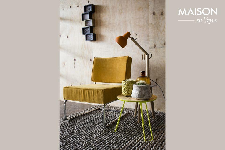 Une chaise confortable associant les styles vintage et industriel