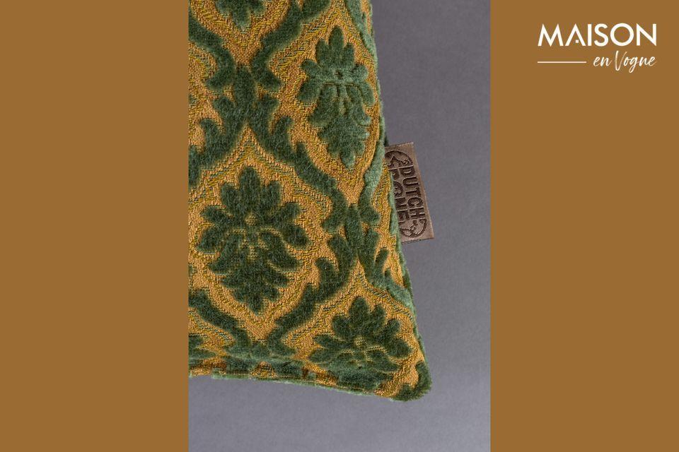 Cet accessoire confortable et décoratif propose un motif végétal répété sur fond uni