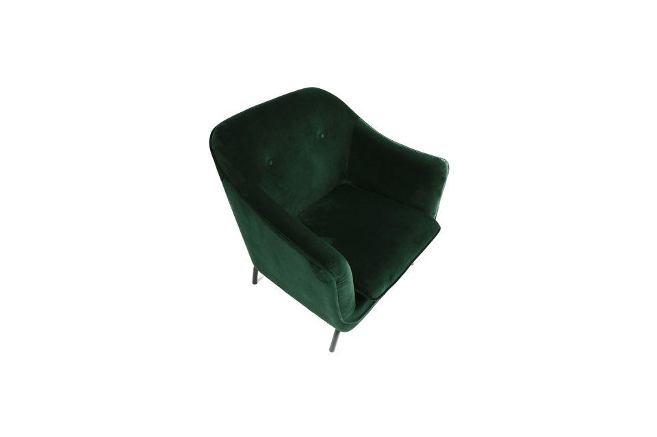 Large fauteuil en velours vert foncé sur pieds en métal.