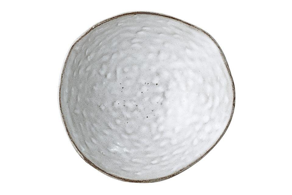 Ce bol gris est très original grâce à son rebord totalement asymétrique