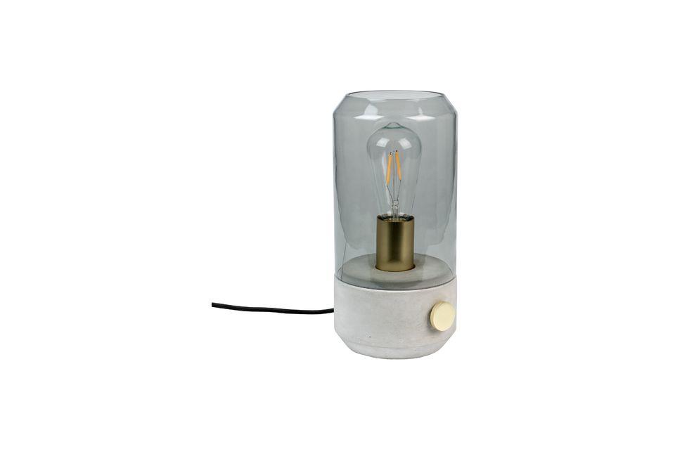 La lampe est enfermée dans une cloche en verre fumé non trempé