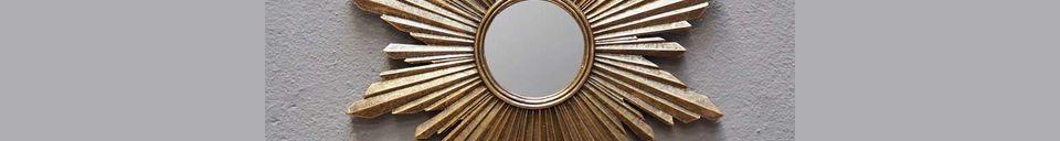 Mise en avant matière Miroir soleil Segrois en résine dorée