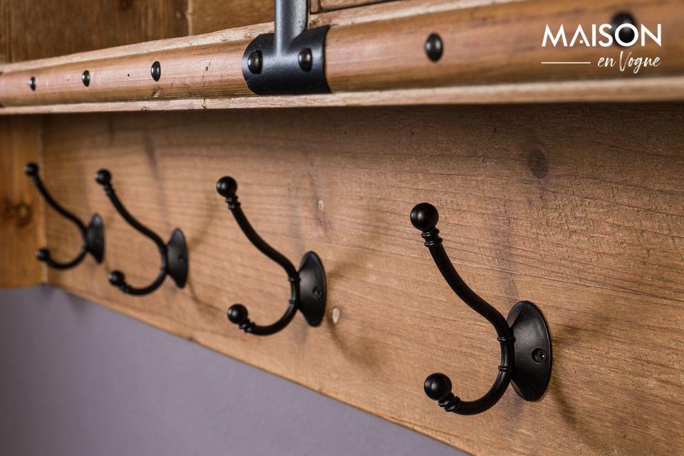 Le porte-manteaux Amador est doté de 5 patères, de 4 tiroirs et d\'un casier ouvert de rangement