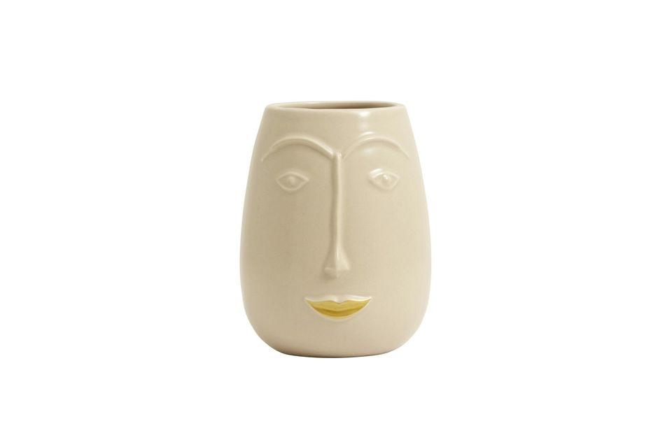 Représentant un visage souriant aux lèvres dorées