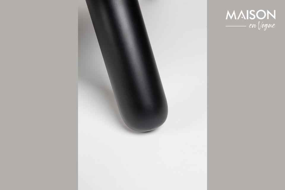 Tel un coussin moelleux effet cuir bicolore posé sur une base légèrement creusée
