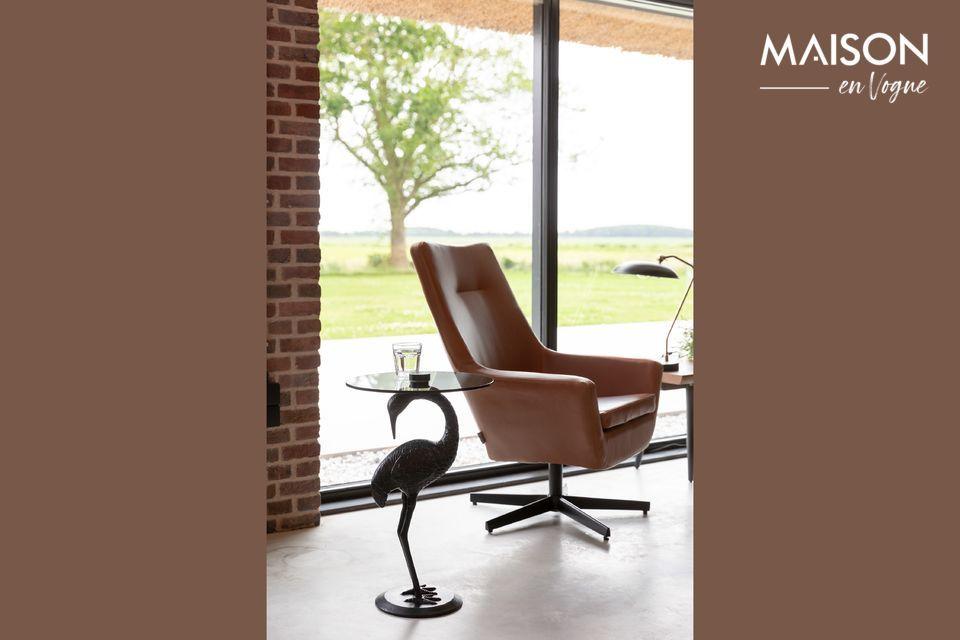 Une table au design élégant avec une grue en guise de pied de table