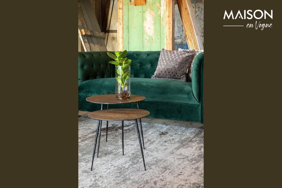 Une table ronde en bois et acier