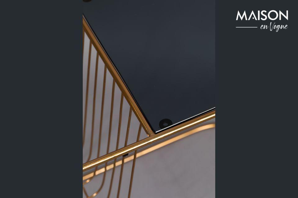 Le pied très fin, en métal doré, reprends la forme du plateau, pour un équilibre parfait