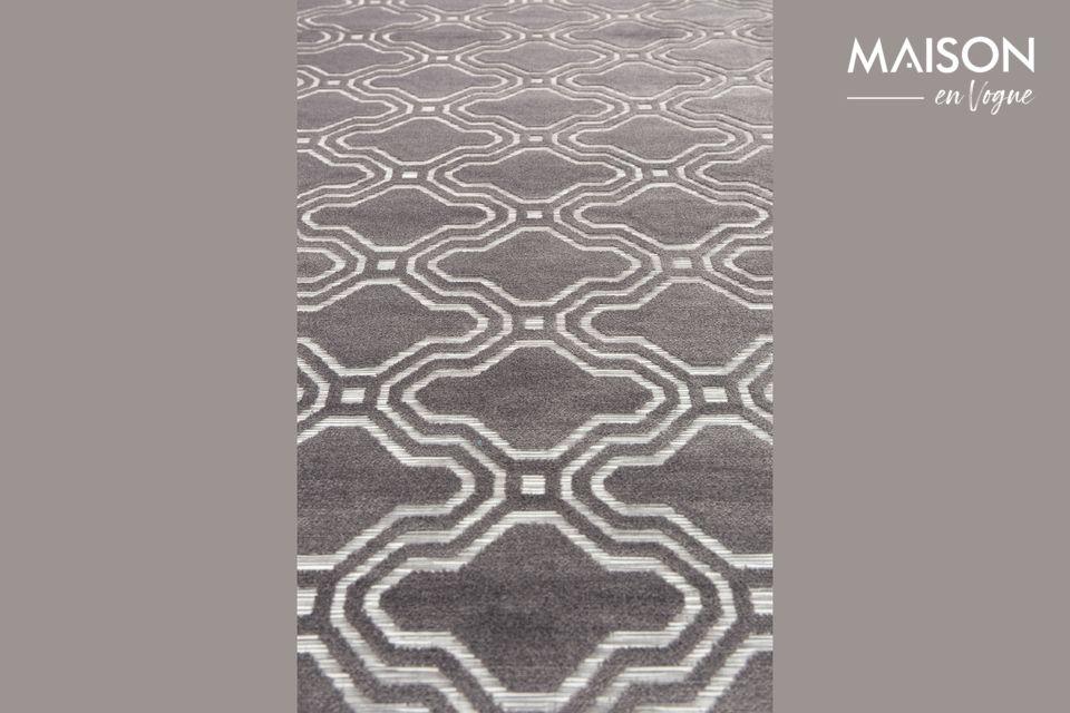 Il fera de l\'effet dans votre salon avec son motif géométrique en relief et bicolore