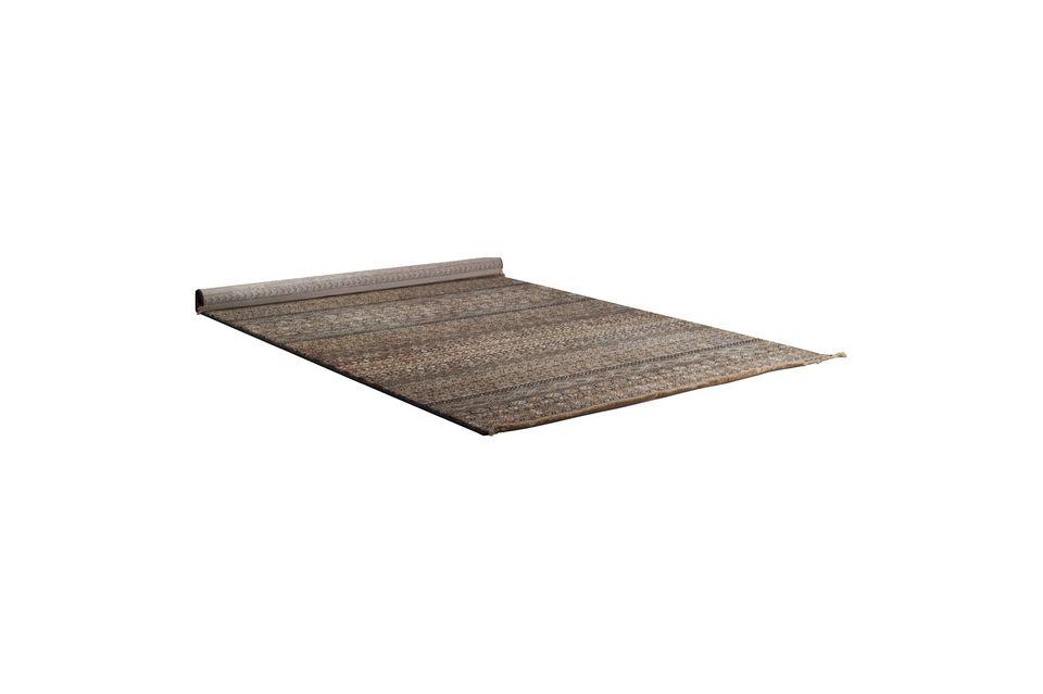 Côté pratique, vous observerez également que ce tapis convient au chauffage par sol