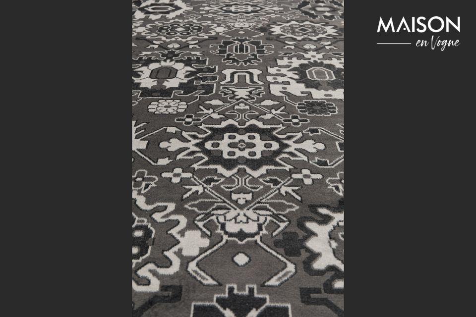Vous découvrez un jeu de motifs modernes et sophistiqués sur ce tapis tissé avec finitions